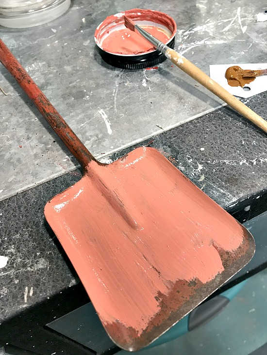 vintage shovel painted with orange chalky paint