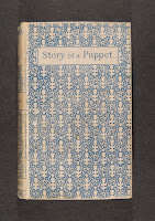 "The book cover for ""Story of a Puppet."""