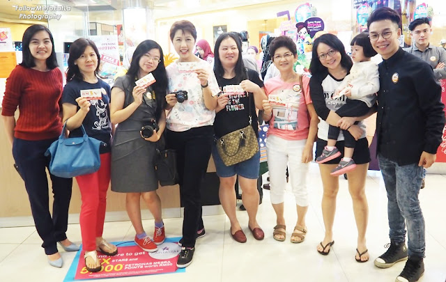 Shoppers With Their Lucky Food Vouchers At Takio Ikayaki