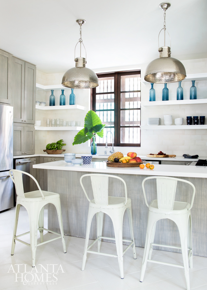 Beautiful white kitchen with open shelving and blue accents