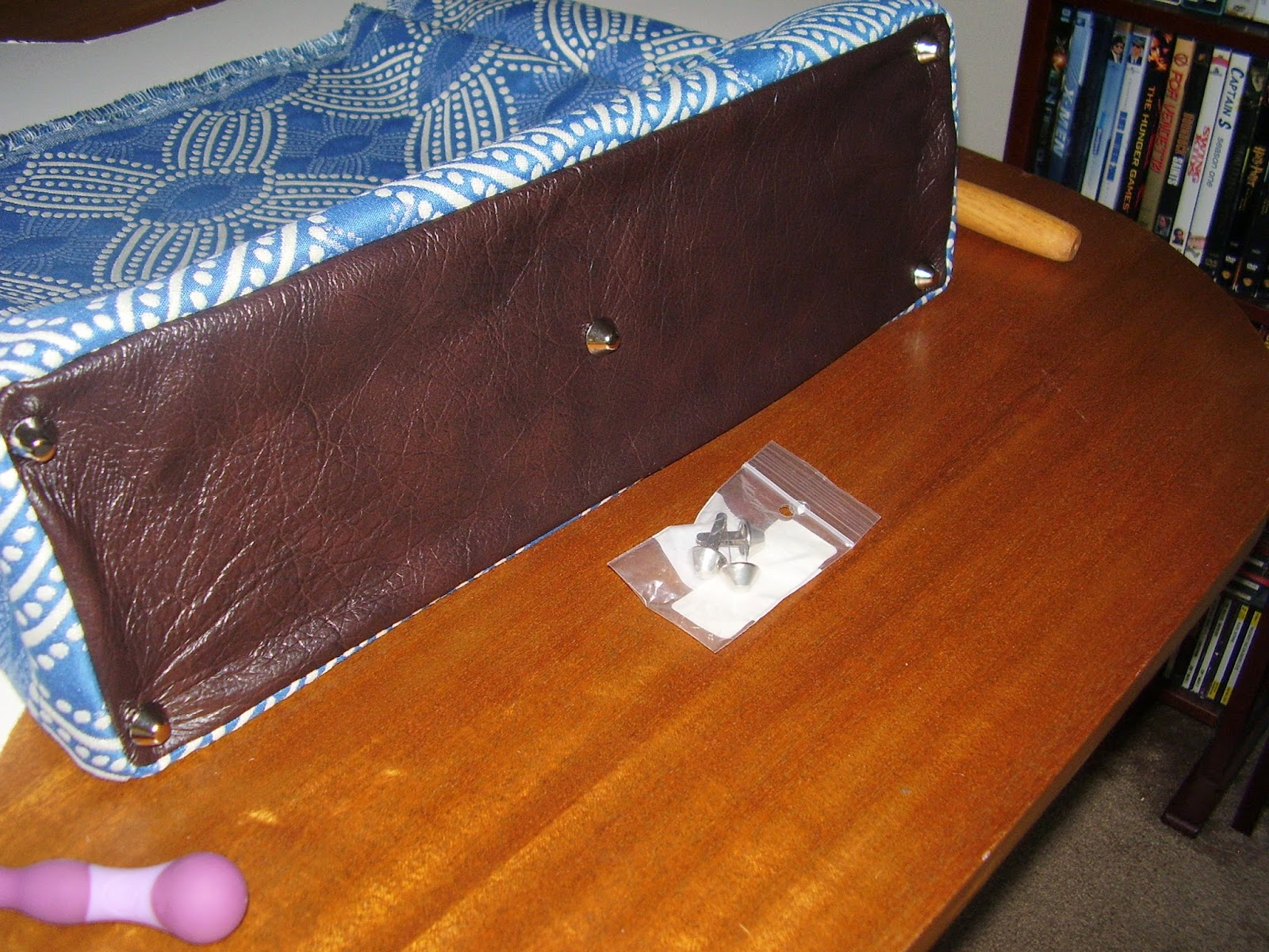 Leather bottom of carpet bag, with five feet.