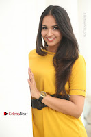 Actress Poojitha Stills in Yellow Short Dress at Darshakudu Movie Teaser Launch .COM 0079.JPG