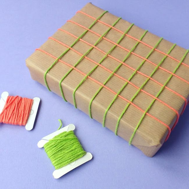 parcel wrapped with a grid of woven threads