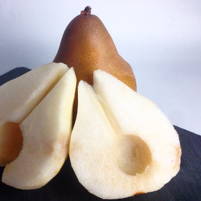 Pealed, Halved and Cored Pears