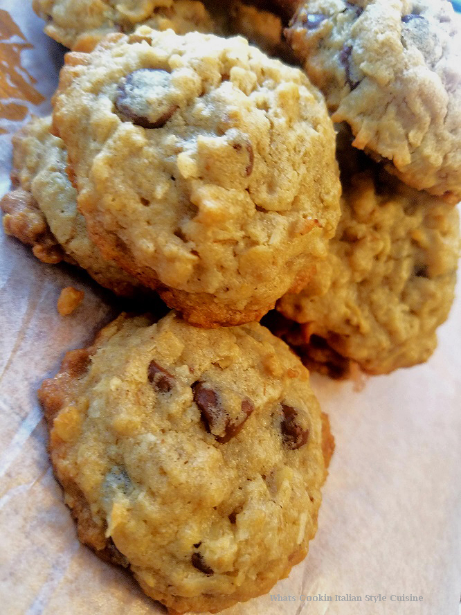 these are the best cowboy cookie loaded with coconut, nuts, chocolate chips, buttery flavored stacked three on top of each other on a white plate. These cookies are famous all over the web sometimes called everything cookies, rock cookies, oatmeal loaded cookies, loaded cookies or cowboy cookies.