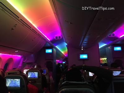 Photo showing the interior of Kenya Airways lighted up in rainbow colours