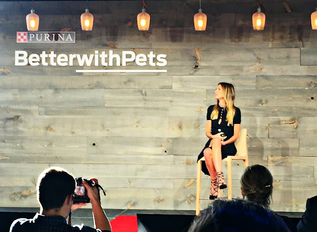 Carole Radziwill sitting in chair and speaking on Purina Better With Pets stage