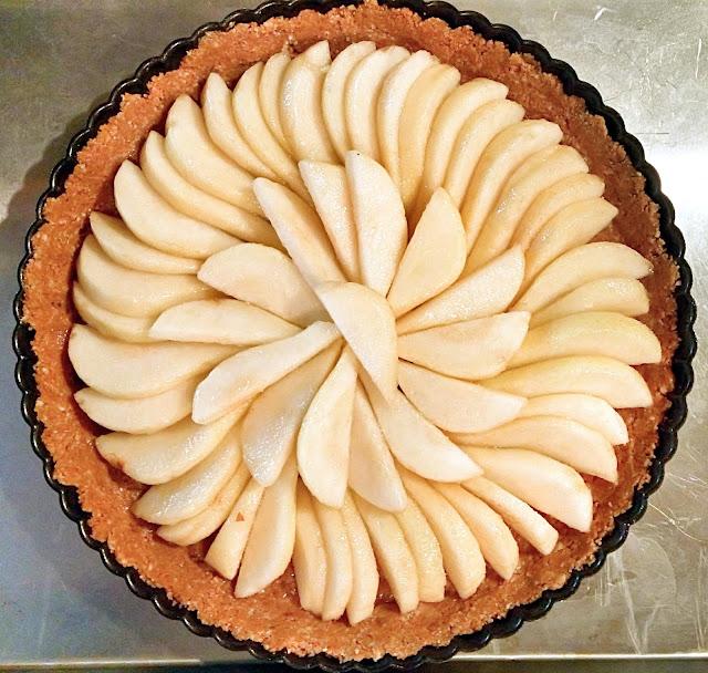 arranged circular pear tart