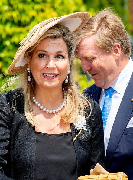 Queen Maxima wore Matthijs van Bergen Coppens Lelies jacket and floral print skirt
