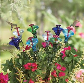 https://squareup.com/market/nestinteriors/mini-blossom-hummingbird-feeder-on-stake-from-par-a-sol