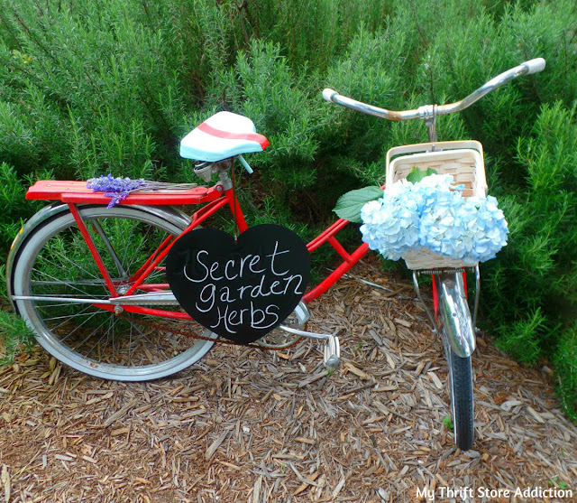 vintage bike seat upcycle and repurposed garden art