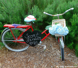 upcycled bike seat and vintage bike garden art