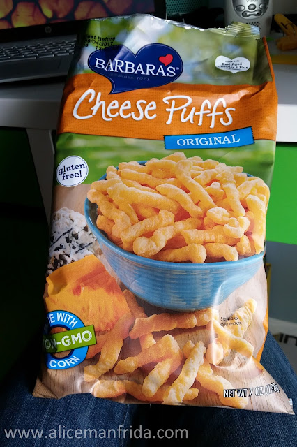 snacking, cheese puffs