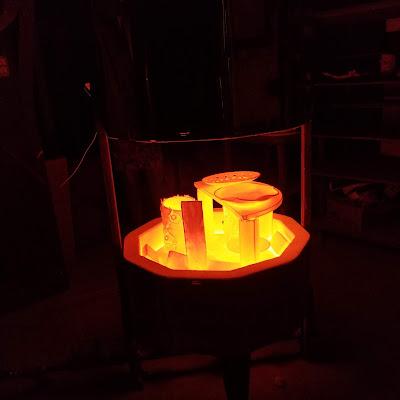 Red hot pottery pieces, during a recent raku firing workshop.