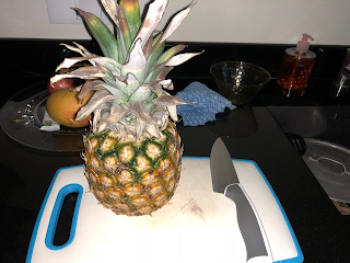 Whole pineapple and a sharp knife