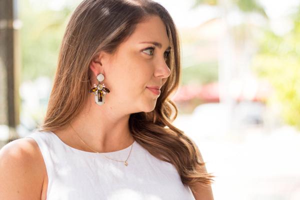 Fashion blogger in Baublebar Bliss earrings.