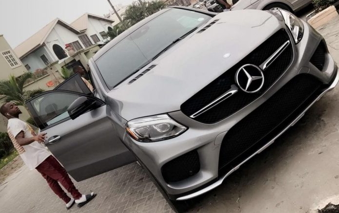 davido sued by car dealer