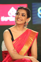 Kajal Aggarwal in Red Saree Sleeveless Black Blouse Choli at Santosham awards 2017 curtain raiser press meet 02.08.2017 077.JPG