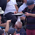 Cricket fans balance objects on sleeping fan's head (Video)