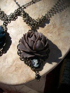 https://www.etsy.com/ca/listing/269659696/grey-rose-necklace-with-miniature-cameo