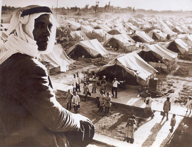 Palestinian man overlooking the refugee camp outside Jaramana, Syria (1948)