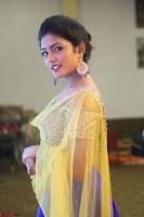 Actress Eesha in Yellow Choli Blue Ghagra at Darshakudu music launch 033.JPG