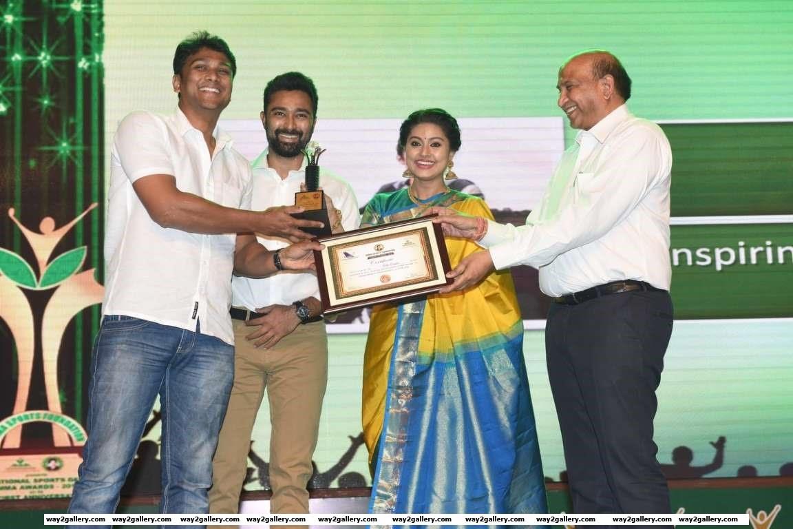 Sneha and Prasanna presented an award to Dilip Roger