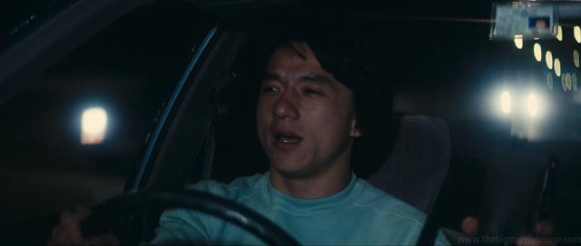 Jackie Chan driving a car