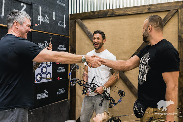 Aubrey Marcus versus Kyle Kingsbury in an archery shoot-out.