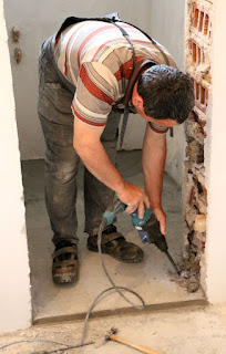 Bekir working on the doorway