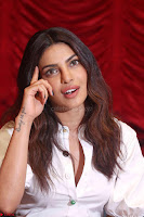 Priyanka Chopra in White Shirt and Colorful Skirt at Baywatch Press Conference  15th May 2017 ~  Exclusive 24.jpg