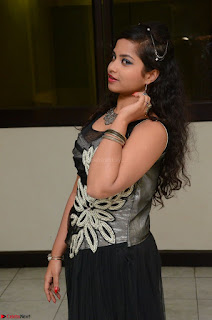 Shrisha Dasari in Sleeveless Short Black Dress At Follow Follow U Audio Launch 043.JPG