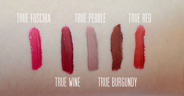 Details on the True Whipped Stain Gloss liquid lip glosses from Studio Gear Cosmetics, available in pebble, fuschia, red, burgundy, and wine.