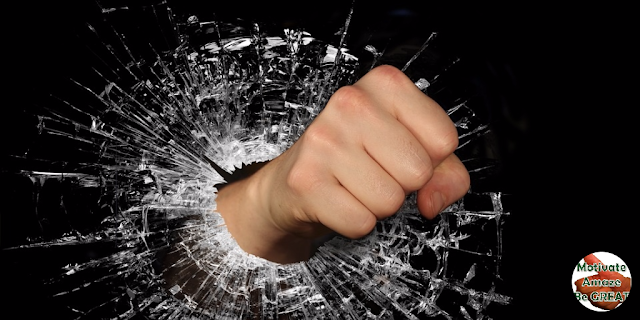 "Featured image in the article: ""38 Words Of Encouragement And Strength For Tough Times"" - A selection of the best quotes and words of wisdom about encouragement and strength when things get hard in life. Fist breaking glass."