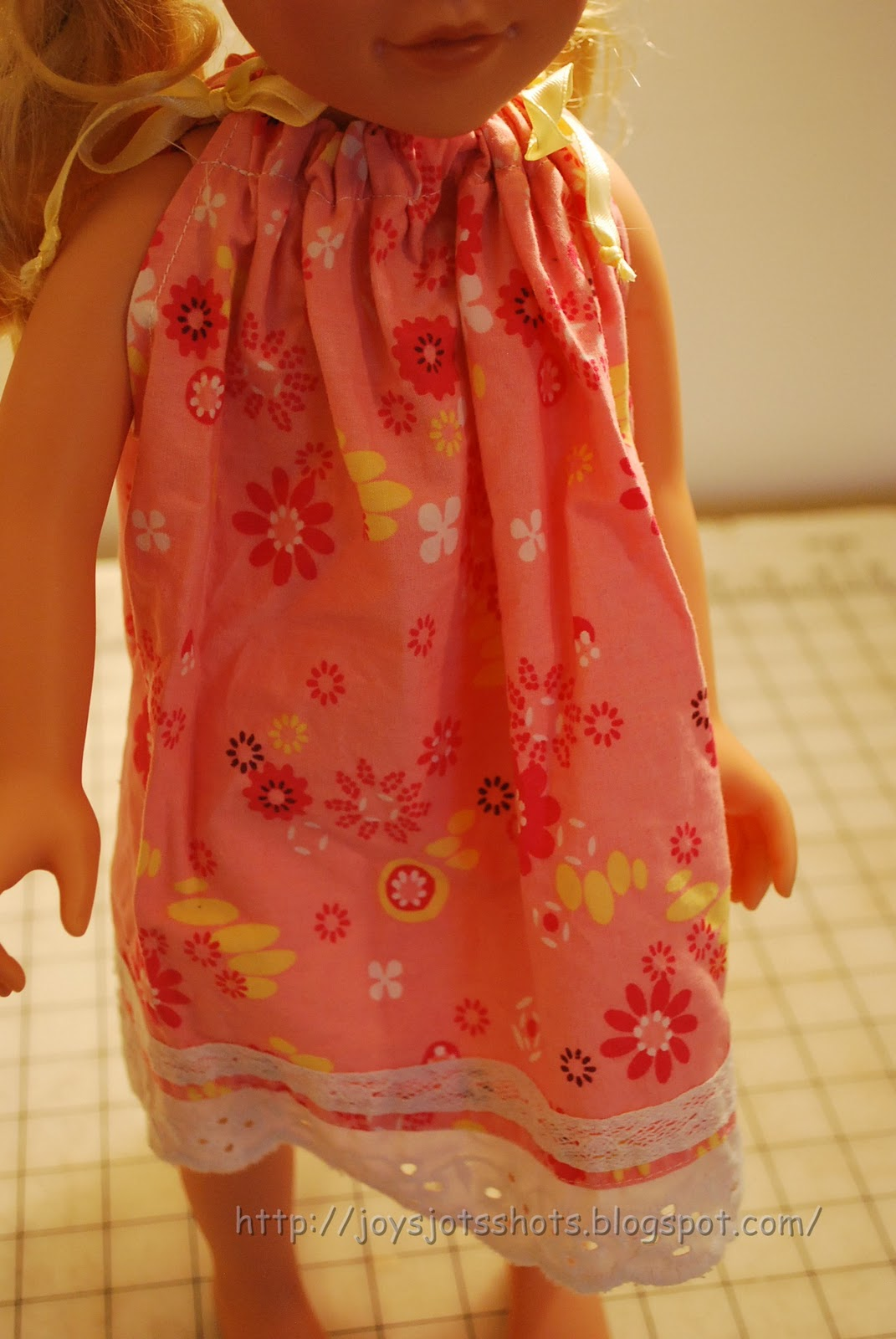 http://joysjotsshots.blogspot.com/2012/01/doll-pillow-case-dress-from-skirt.html