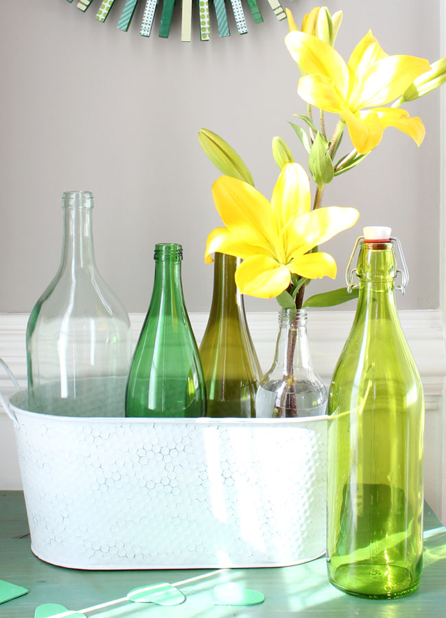 a picture of beautiful lilies in green bottles for St.Patrick's day
