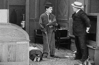 Кадр из фильма Чарли Чаплина The New Janitor (1914) - 10