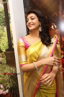Actress Kajal Agarwal Stills in Golden Silk Saree at Trisha Sesigner Store Launch  0040.jpg