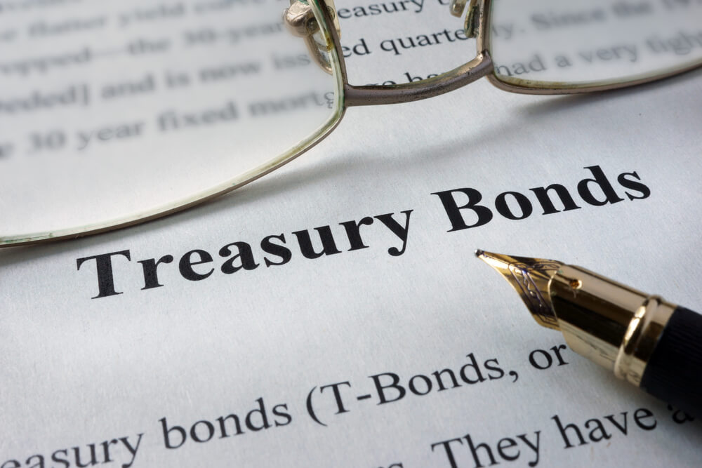 close up shot of a paper with Treasury bonds written on it
