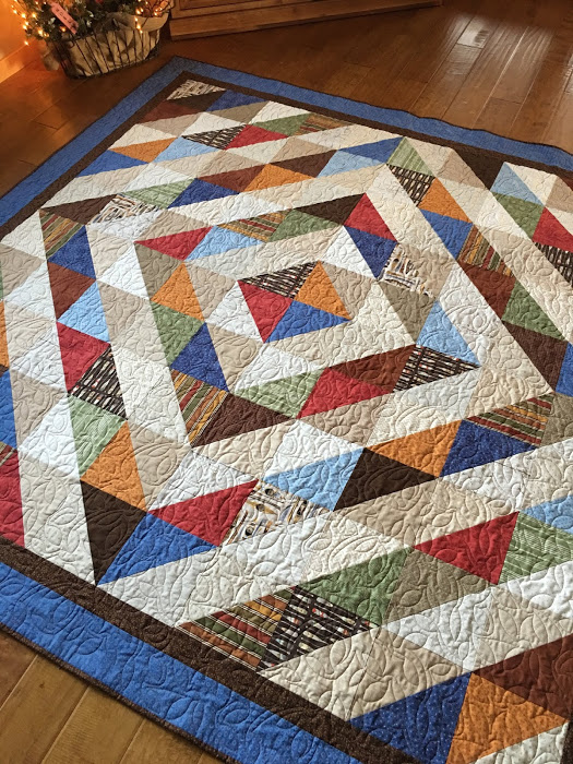 Luke's HST Around the World Quilt Free Pattern designed by Taunja Kelvington of Carried Away Quilting