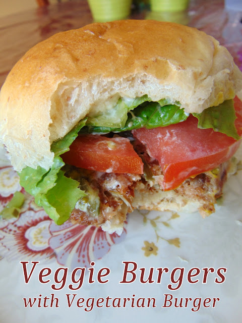 Veggie Burger with Vegetarian Burger in a bun with lettuce, tomato and condiments.