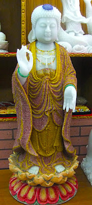 White jade Buddha with ruby and gold decoration