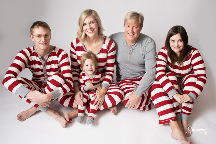 out for christmas in their matching pajamas from burt bees baby their youngest townes sure had fun jumping on the bed in the studio