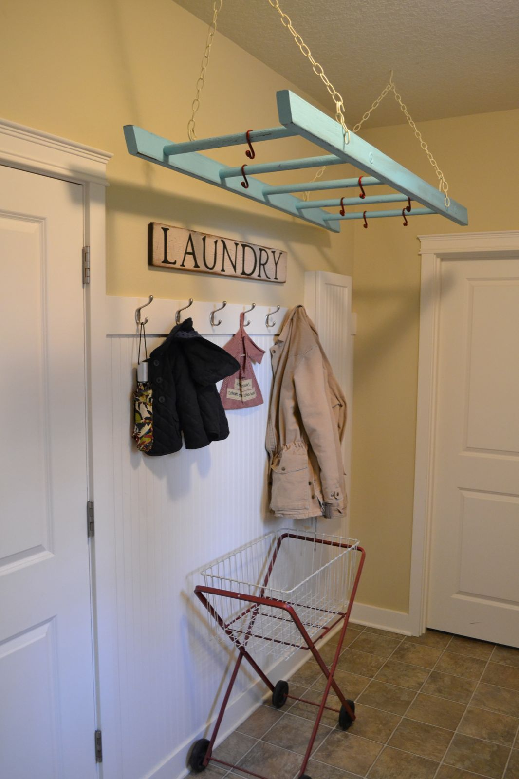 Hanging ladder adds storage in the laundry room