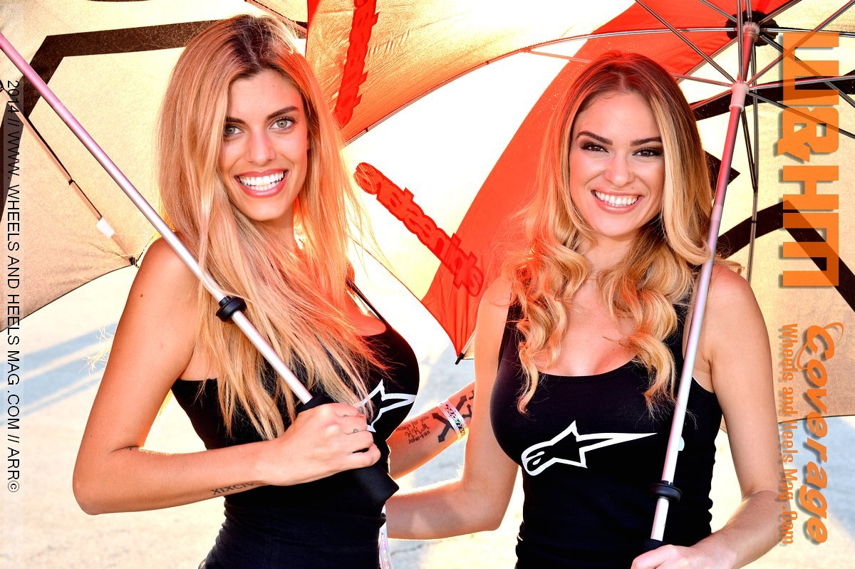 Close up of Autumn Allenbach and Daniella umbrella girls car models at Alpinestars in 2014 Formula Drift Irwindale with black tank top and denim shorts