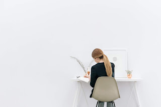 woman sitting at a desk working