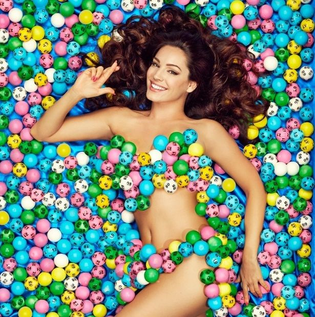 PROD-Kelly-Brook-lying-on-a-bed-of-Lotto-balls