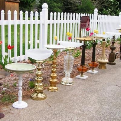 old lamps with broken shades can be turned into bird baths to accessorize a garden