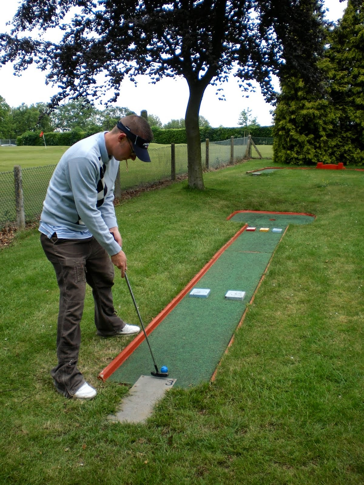 Playing hole 3 of the Wardown Park Crazy Golf course in Luton in 2007