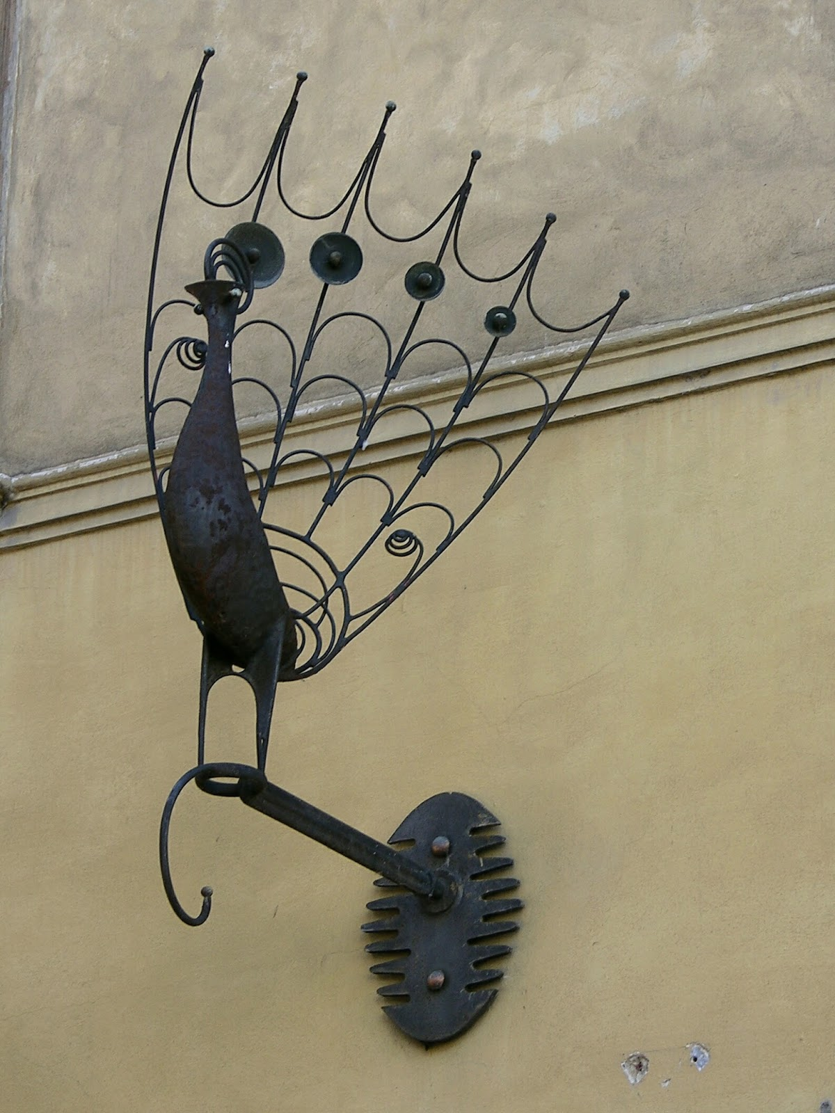 This Unusual Wrought Iron Sign Portrays The Display Of A Pea With Spread Tail